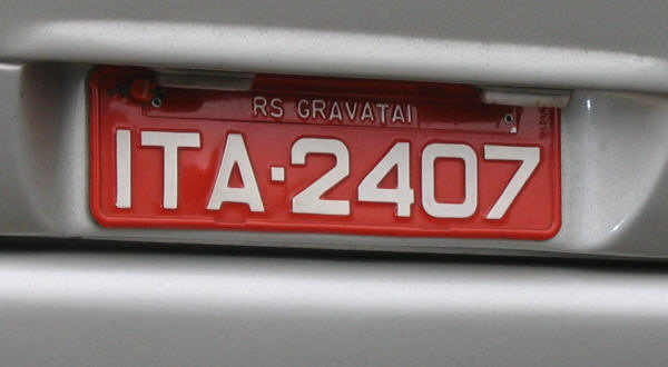 the colors of the plates vary according to the use of the vehicle black letters on gray background for privately owned vehicles white